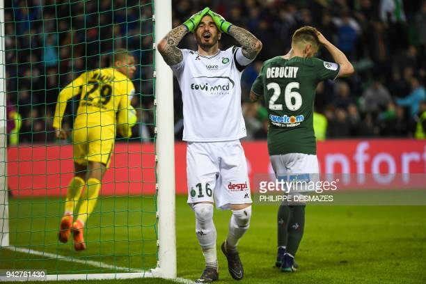 Saint-Etienne's French goalkeeper Stephane Ruffier reacts after Saint-Etienne's French defender Mathieu Debuchy scored a last minute own goal,...