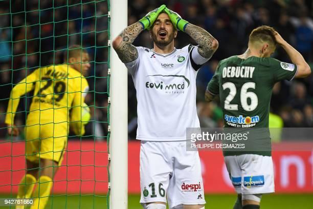Saint-Etienne's French goalkeeper Stephane Ruffier reacts after Saint-Etienne's French defender Mathieu Debuchy scored a last minute own goal, as...