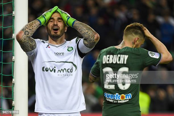 SaintEtienne's French goalkeeper Stephane Ruffier reacts after SaintEtienne's French defender Mathieu Debuchy scored a last minute own goal allowing...