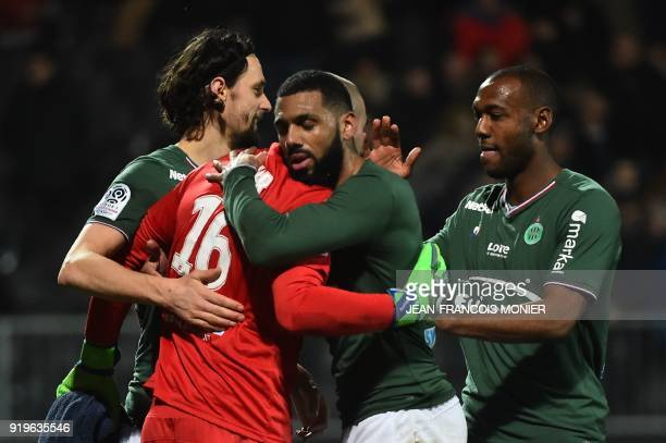 SaintEtienne's French goalkeeper Stéphane Ruffier is congratulated by SaintEtienne's Bosnia and Herzegovina defender Neven Subotic SaintEtienne's...
