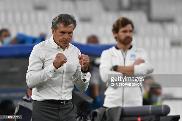 Saint-Etienne's French head coach Claude Puel celebrates next to Marseille's Portuguese coach Andre Villas Boas during the French L1 football match...
