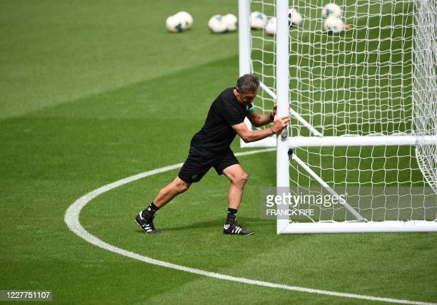 SaintEtienne's French head coach Claude Puel takes part in a training session at the Stade de France stadium in SaintDenis on the outskirts of Paris...