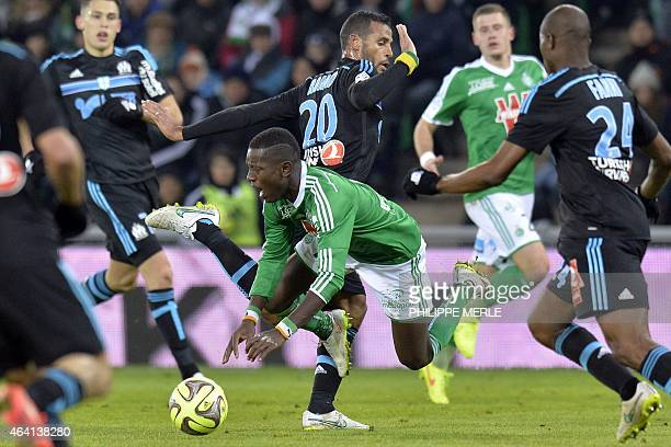 SaintEtienne's French Ivorian forward MaxAlain Gradel vies with Marseille's Togolese midfielder JacquesAlaixys Romao during the French L1 football...