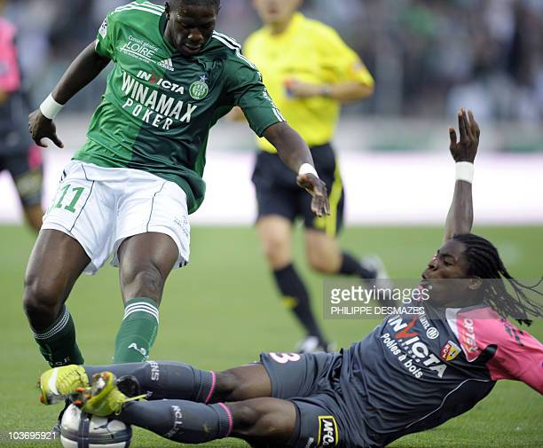 SaintEtienne's French midfielder Bakary Sako is tackled by Lens' French defender Christopher Aurier during the French L1 football match SaintEtienne...