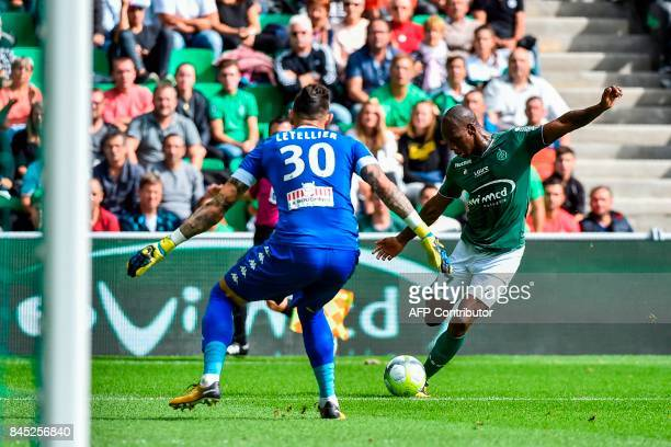 SaintEtienne's French midfielder Bryan Dabo shoots on goal against Angers' French goalkeeper Alexandre Letellier during the French L1 football match...