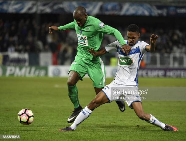SaintEtienne's French midfielder Bryan Dabo vies with Auxerre's French defender KenjiVan Boto during the French Cup football match AJ Auxerre against...