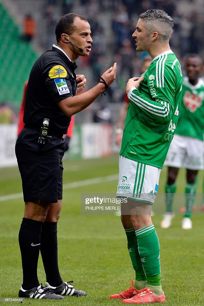 Saint-Etienne's French midfielder Fabien Lemoine (R) argues with French referee Said Ennjimi during the French L1 football match Saint-Etienne (ASSE) vs Lille (LOSC) on March 22, 2015 at the Geoffroy-Guichard stadium in Saint-Etienne.