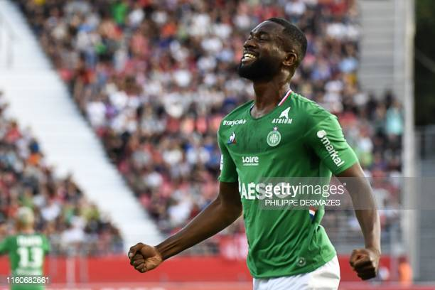 SaintEtienne's French midfielder JeanEudes Aholou celebrates after scoring a goal during the French L1 football match between Dijon FCO and AS...