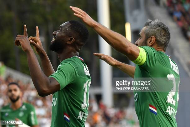 Saint-Etienne's French midfielder Jean-Eudes Aholou celebrates with Saint-Etienne's French defender Loic Perrin after scoring a goal during the...