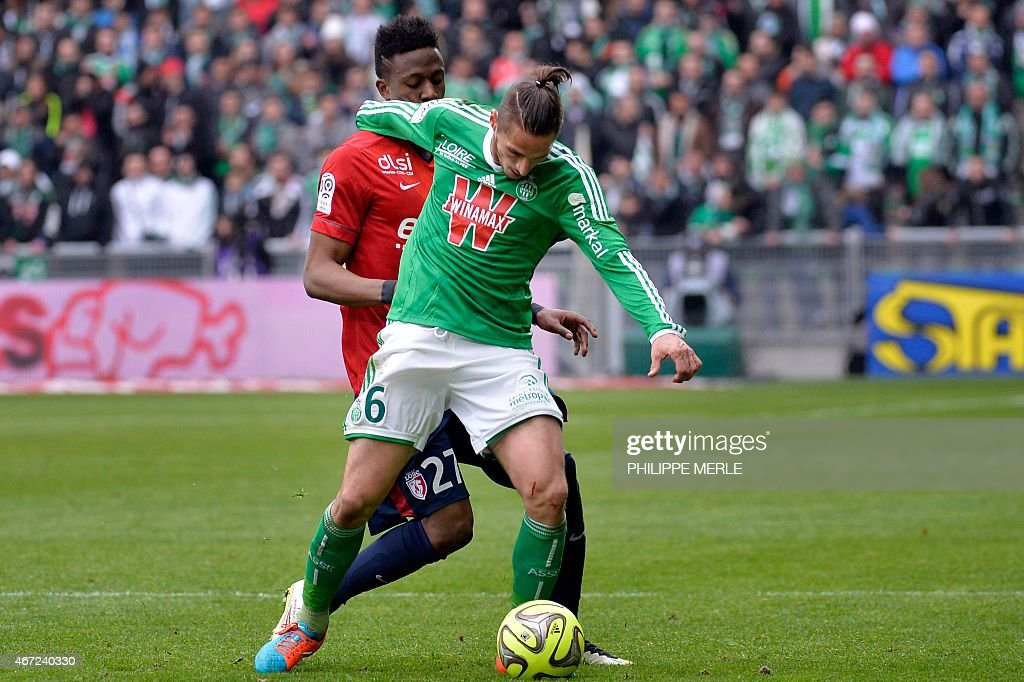 Saint-Etienne's French midfielder Jeremy Clement (R) vies with Lille's belgian forward Divock Origi during the French L1 football match Saint-Etienne (ASSE) vs Lille (LOSC) on March 22, 2015 at the Geoffroy-Guichard stadium in Saint-Etienne.