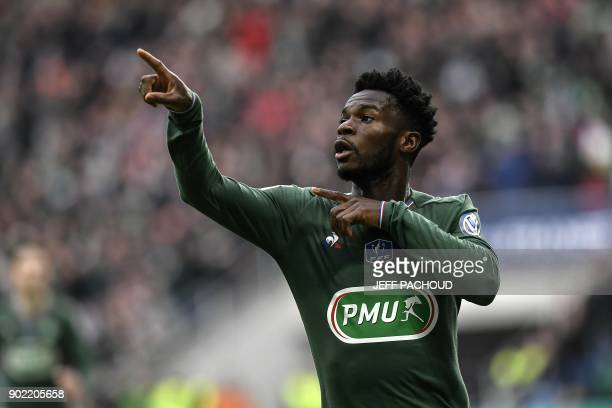 SaintEtienne's French midfielder Jonathan Bamba celebrates after scoring a goal during the French Cup football match Saint Etienne vs Nimes on...