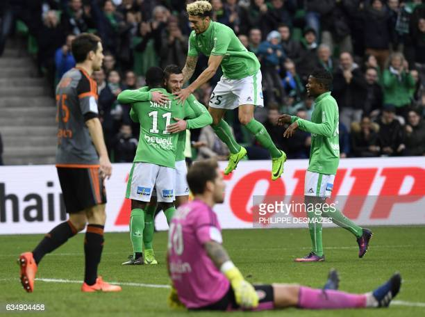 SaintEtienne's French midfielder Jordan Veretout celebrates with teammates after scoring a goal as Lorient's French goalkeeper Benjamin Lecomte lies...