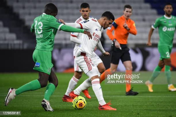 SaintEtienne's French midfielder Lucas Gourna fights for the ball withLyon's French midfielder Houssem Aouar during the French L1 football match...