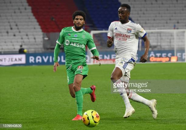 SaintEtienne's French midfielder Mahdi Camara fights for the ball with Lyon's Zimbabwean forward Tino Kdewere during the French L1 football match...