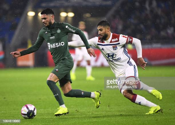 SaintEtienne's French midfielder Remy Cabella vies with Lyon's French midfielder Nabil Fekir during the French L1 football match between Lyon and...