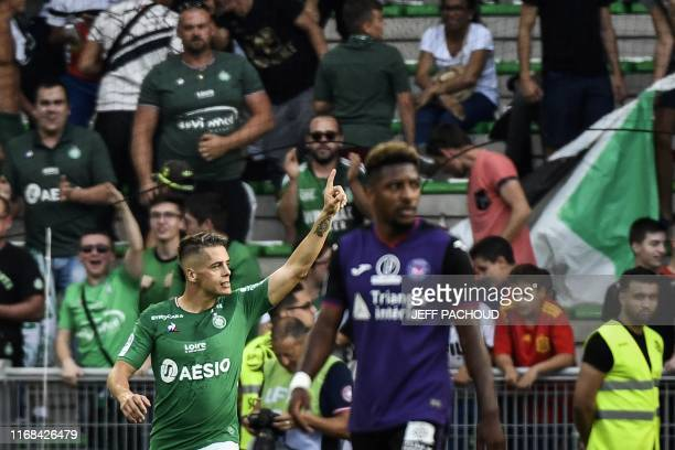 SaintEtienne's French midfielder Romain Hamouma celebrates after scoring a goal during the French L1 football match between AS SaintEtienne and...