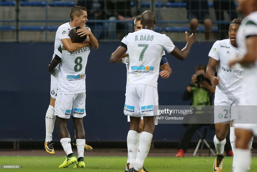 Saint-Etienne's French midfielder Romain Hamouma (top-L) celebrates with teammates after scoring during the French L1 football match between Caen (SMC) and Saint-Etienne (ASSE) on August 12, 2017, at the Michel d'Ornano stadium, in Caen, northwestern France. /