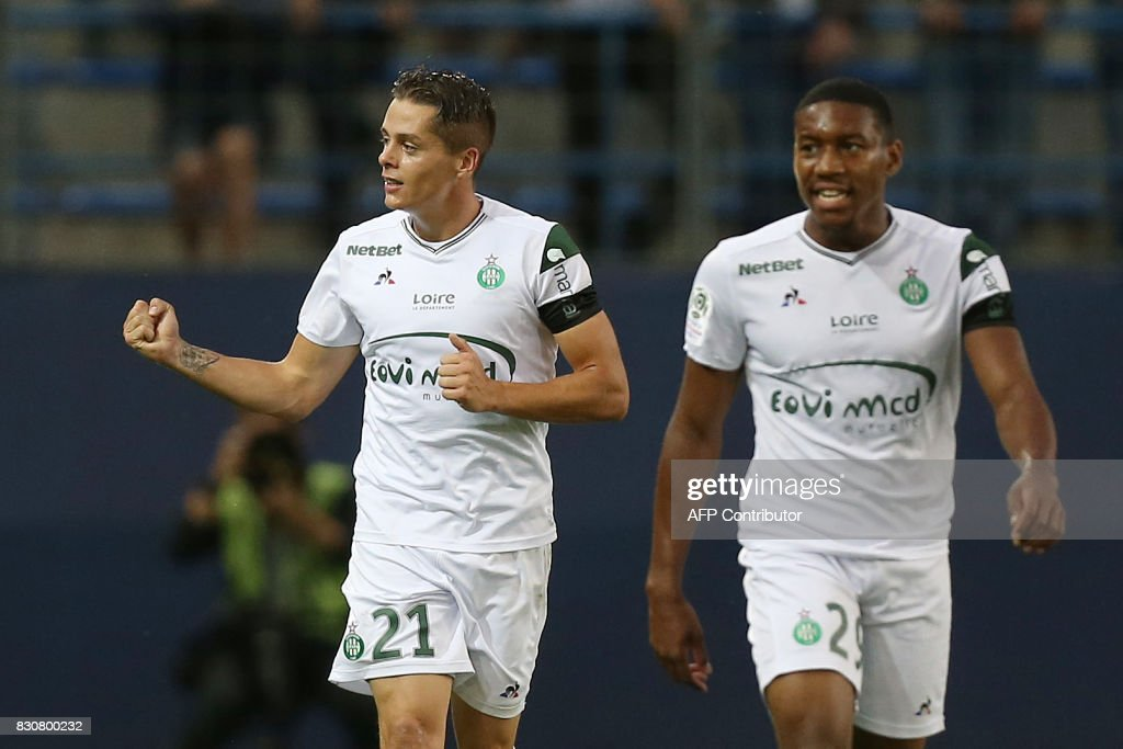Saint-Etienne's French midfielder Romain Hamouma (L) celebrates with teammates after scoring during the French L1 football match between Caen (SMC) and Saint-Etienne (ASSE) on August 12, 2017, at the Michel d'Ornano stadium, in Caen, northwestern France. /