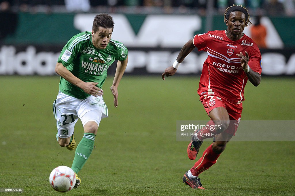 Saint-Etienne's French midfielder Romain Hamouma (L) fights for the ball with Valenciennes' Cameroonian defender Gaetan Bong during the French L1 football match Saint-Etienne vs Valenciennes, on November 23, 2012 at the Geoffroy-Guichard stadium in Saint-Etienne.