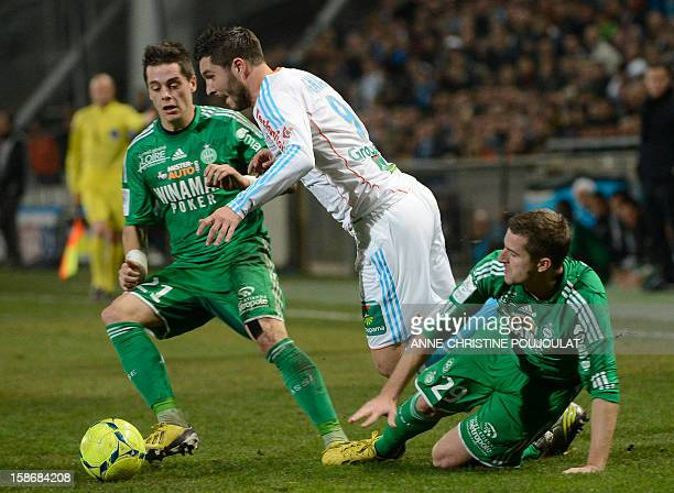 SaintEtienne's French midfielder Romain Hamouma vies with Marseille's French midfielder Andre Pierre Gignac on December 23 2012 at the Velodrome...
