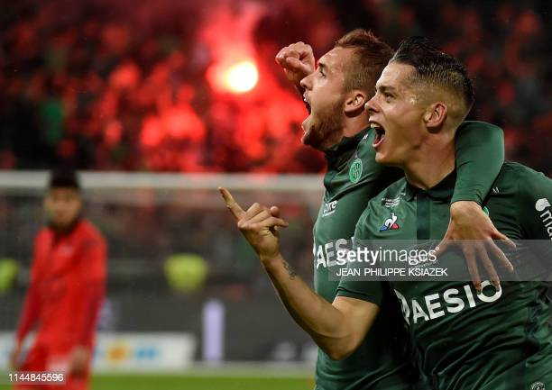 Saint-Etienne's French midfielder Romain Hamouna celebrates with Saint-Etienne's Argentinian midfielder Valentin Vada after scoring a goal during the...