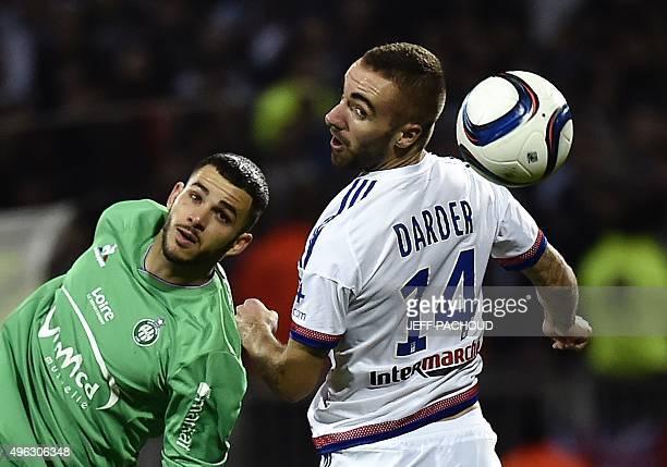 SaintEtienne's French midfielder Valentin Esseric challenges Lyon's Spanish midfielder Sergi Darder during the French L1 football match between Lyon...