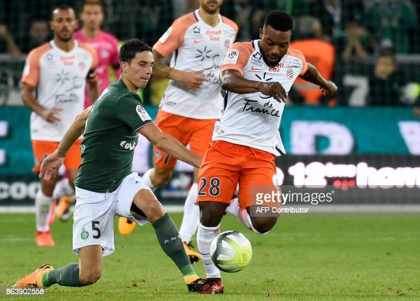 SaintEtienne's French midfielder Vincent Pajot vies with Montpellier's Montpellier's French midfielder Stephane Sessegnon during the French L1...