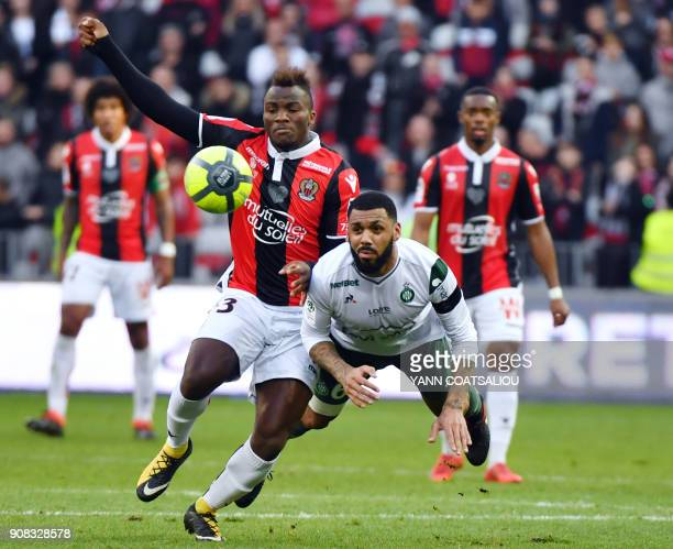 SaintEtienne's French midfielder Yann M'vila vies with Nice's Cameroonian forward Igniatius Knepe Ganago during the French L1 football match between...