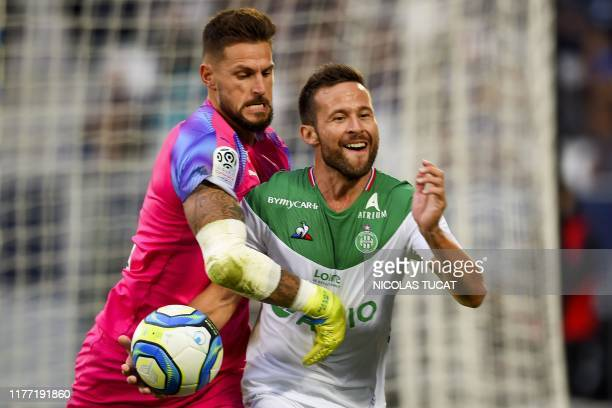 Saint-Etienne's French midfielder Yohan Cabaye celebrates after his team scored a penalty kick while Bordeaux's French goalkeeper Benoit Costil tries...