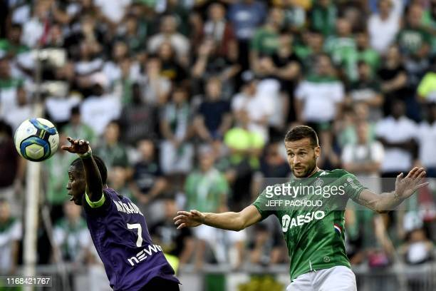 Saint-Etienne's French midfielder Yohan Cabaye vies with Toulouse's French forward Max Alain Gradel during the French L1 football match between AS...