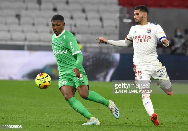 SaintEtienne's French midfielder Zaydou Youssouf fights for the ball withLyon's French midfielder Houssem Aouar during the French L1 football match...