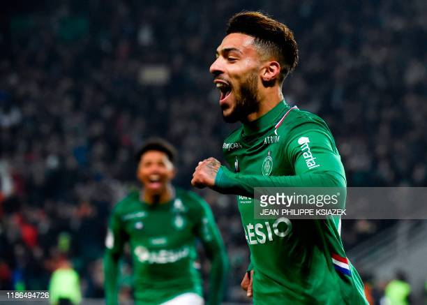 Saint-Etienne's Gabonese forward Denis Bouanga celebrates after scoring a goal during the French L1 football match between Saint-Etienne and Nice, on...
