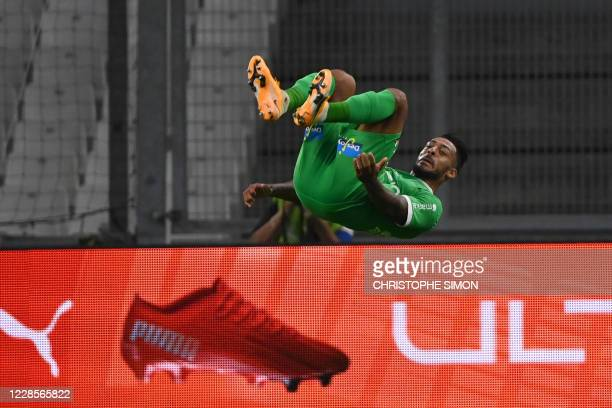 Saint-Etienne's Gabonese forward Denis Bouanga celebrates after scoring a goal during the French L1 football match between Marseille and...