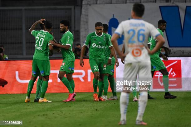 Saint-Etienne's Gabonese forward Denis Bouanga celebrates with temmates after scoring a goal during the French L1 football match between Marseille...