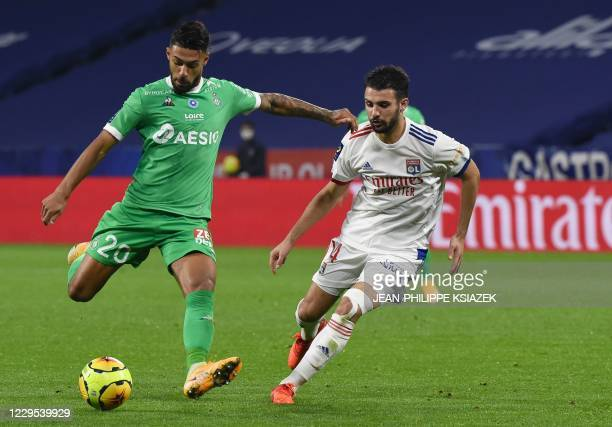 SaintEtienne's Gabonese forward Denis Bouanga fights for the ball withLyon's French defender Leo Dubois during the French L1 football match between...