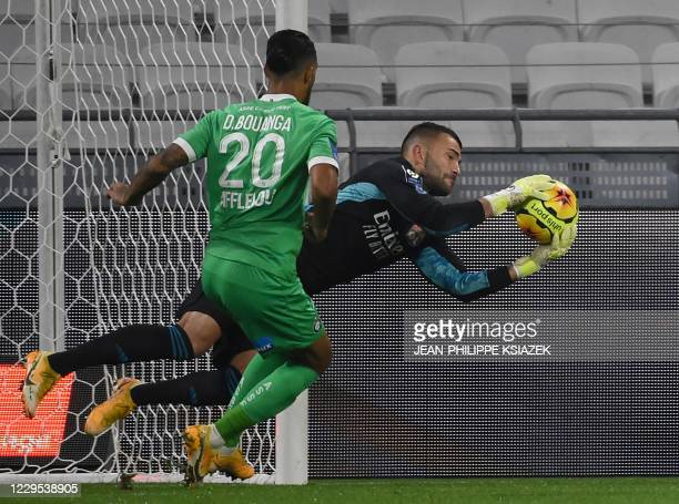 SaintEtienne's Gabonese forward Denis Bouanga fights for the ball with Lyon's Portuguese goalkeeper Anthony Lopes during the French L1 football match...