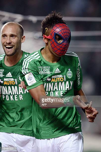 SaintEtienne's Gabonese forward PierreEme Aubameyang wears a spiderman mask after scoring a goal during the French L1 football match AS SaintEtienne...