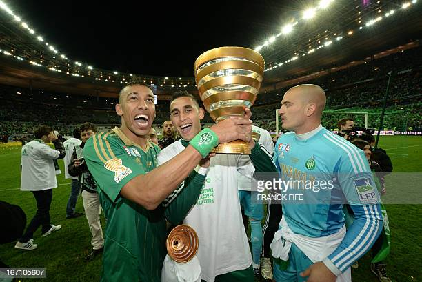 SaintEtienne's Gabonese forward PierreEmerick Aubameyang and team mates celebrate after winning the French League Cup final football match between...