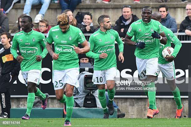 SaintEtienne's Guinean defender Florentin Pogba celebrates with teammates after scoring a goal during the French Ligue 1 football match between...