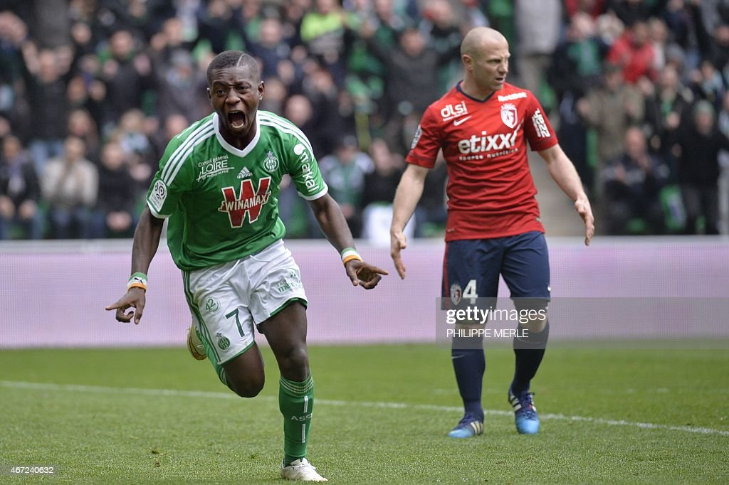 Saint-Etienne's Ivorian forward Max-Alain Gradel (L) celebrates after scoring a goal during the French L1 football match Saint-Etienne (ASSE) vs Lille (LOSC) on March 22, 2015 at the Geoffroy-Guichard stadium in Saint-Etienne.