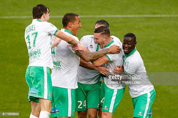 SaintEtienne's Jordan Veretout celebrates with teammates after scoring a goal during the French L1 football match between Caen and SaintEtienne on...