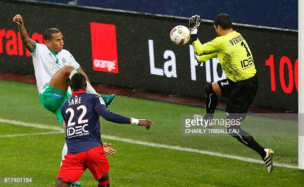SaintEtienne's Leo Lacroix vies for the ball with Caen's French goalkeeper Remy Vercoutre during the French L1 football match between Caen and...