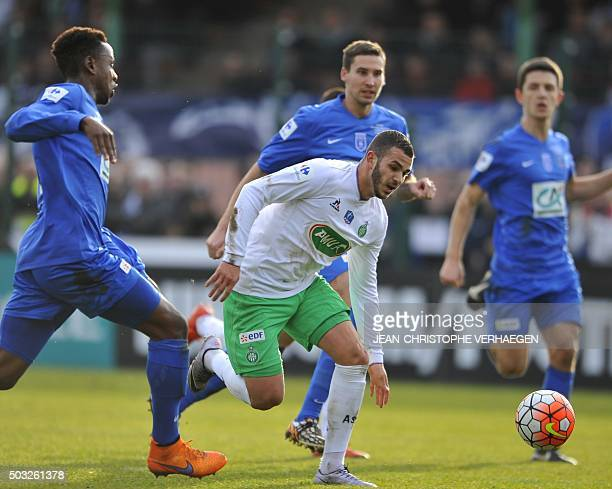 SaintEtienne's Neal Maupay vies with Raon's Kelly Irep during a French Cup round of 64 football match between Raon l'Etape and SaintEtienne in Raon...