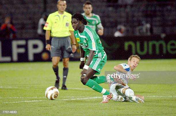 SaintEtienne's player Bafetimbi Gomis is tackled by Auxerre's player Benoit Pedretti 25 September 2007 at AbbeDeschamp stadium in Auxerre during...