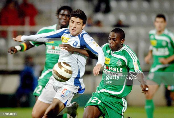 SaintEtienne's player Mouhamadou Dabo fights for the ball with Auxerre's player George Daniel Niculae 25 September 2007 at AbbeDeschamp stadium in...