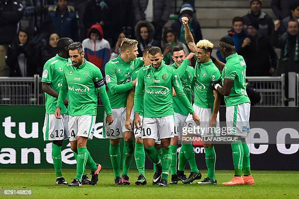 SaintEtienne's players celebrate after scoring a goal during the French L1 football match between SaintEtienne and Guinguamp on December 11 2016 at...