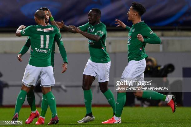 Saint-Etienne's players celebrate after scoring during the French Cup quarter-final football match between SAS Epinal and AS Saint-Etienne at Marcel...