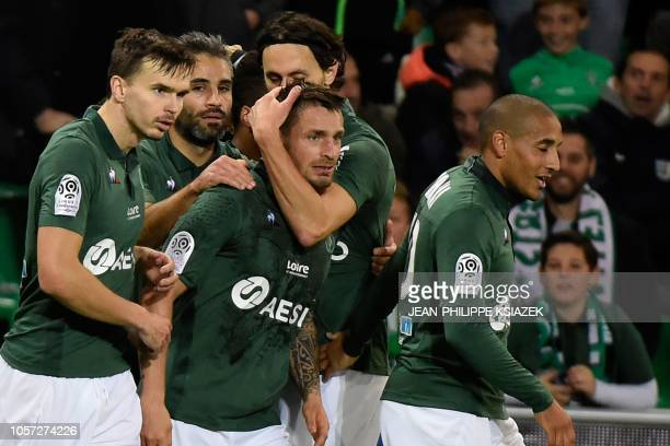 SaintEtienne's players celebrates after scoring a goal during the French L1 football match between SaintEtienne and Angers on November 4 at the...