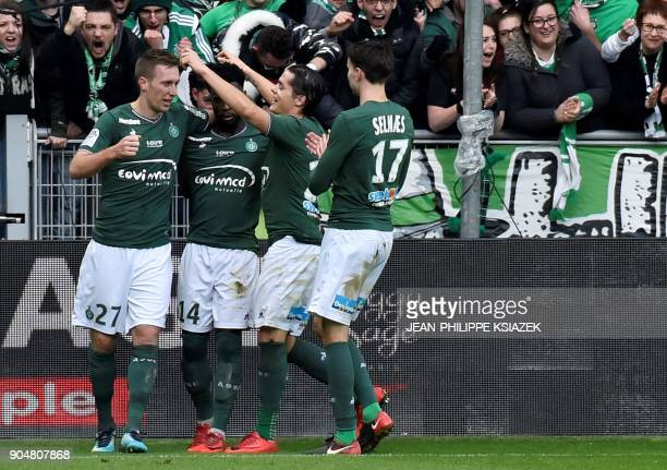 SaintEtienne's players celebrates after scoring a goal during the French L1 football match SaintEtienne vs Toulouse on January 14 at the Geoffroy...