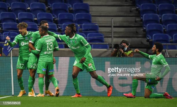 SaintEtienne's players celebrates after scoring during the French L1 football match between Lyon and SaintEtienne on November 8 at the Groupama...